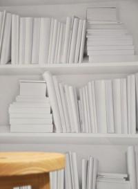White Trompe l'oeil bookshelves wallpaper by Studio Mold