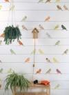 Papier peint Oiseaux sur fils vert et mauve par Inke
