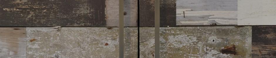 Detail of cupbaord with 'Scrapwood' wallpaper